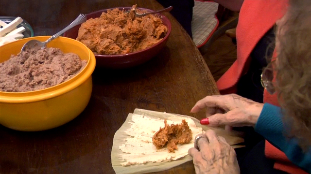 making pork tamales by hand