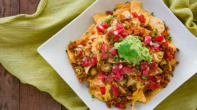Loaded Vegan Nachos are the way to make your favorite Mexican dish healthy.