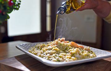 Adding the finishing touch to the Shrimp and Leek Risotto